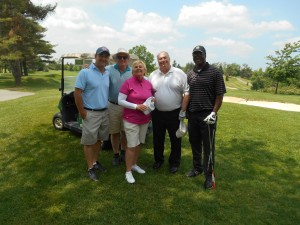 Lawyers from Prouse, Dash & Crouch, LLP get a golf lesson from LGPA champion Sandra Post.